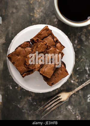 homemade brownies on a dessert plate and coffee. - Stock Photo