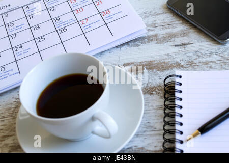 Checking monthly activities and appointments at the office - Stock Photo