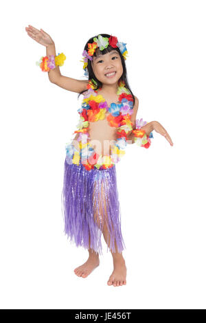 Asian Chinese little girl in hawaiian costume pretending to be a Hula Dancer in isolated white background - Stock Photo
