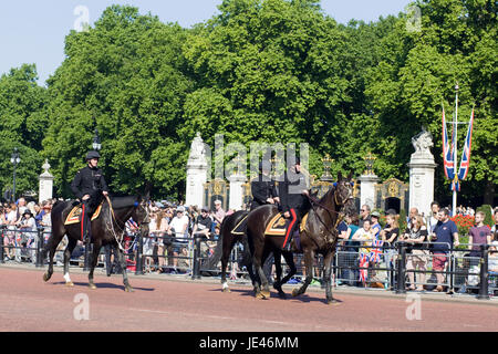 Members of the Household cavalry greeting the crowds while preparing to join Trooping the colour - Stock Photo