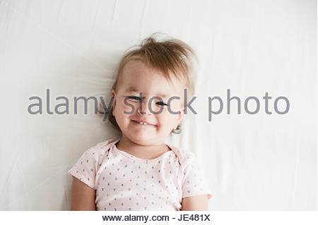 Friendly one year old baby smiling - Stock Photo