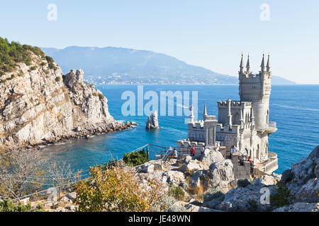 GASPRA, RUSSIA - SEPTEMBER 29, 2014: Black Sea coastline with Swallow's Nest castle in Crimea. The castle was built - Stock Photo