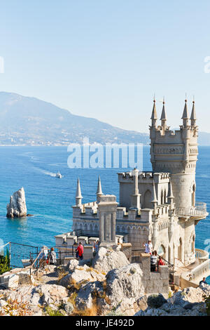 GASPRA, RUSSIA - SEPTEMBER 29, 2014: tourists near Swallow's Nest castle in Crimea. The castle was built in 1911 - Stock Photo