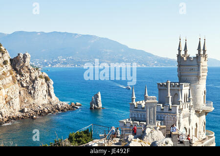 GASPRA, RUSSIA - SEPTEMBER 29, 2014: view of Black Sea coast with Swallow's Nest castle in Crimea. The castle was - Stock Photo