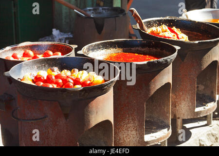 ovens with tatar cooking on outdoor cafe in Crimea - Stock Photo