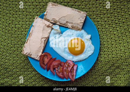 Extruded beard and fried egg. - Stock Photo