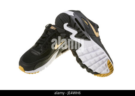 BURGAS, BULGARIA - DECEMBER 29, 2016: Nike Air MAX women's shoes - sneakers in black, isolated on white, with clipping - Stock Photo