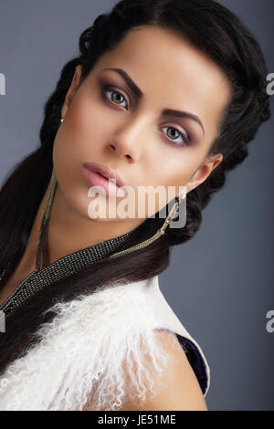 Fascination. Face of Young Nice Looking Brunette with Earrings - Stock Photo
