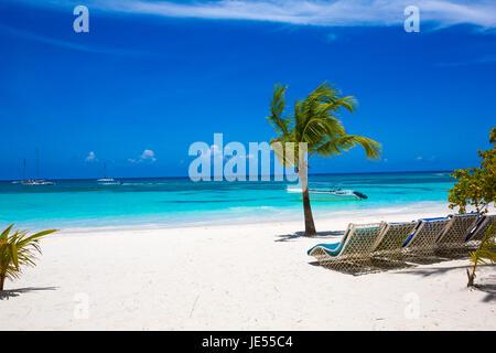 Sunbed on topical beach ,Beach chairs on sand - Stock Photo