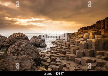 According to legend, the interlocking basalt columns are the remains of a causeway built by legendary giant Finn - Stock Photo