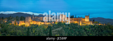 Panorama of Alhambra - medieval Moorish fortress surrounded by yellow autumn trees illuminated in the evening, Granada, - Stock Photo