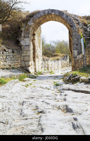 Gate on fortified Middle wall of medieval town chufut-kale, crimea - Stock Photo