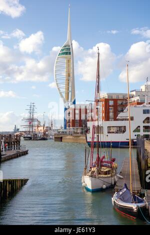 Porstmouth Harbour showing the Emirates Spinnaker Tower, the Isle of Wight car ferry, tall ships and sailing boats - Stock Photo