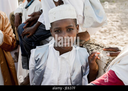 Young muslim attends the Zefe procession during the festival of Maulidi, the birth of the prophet Mohammed, Lamu - Stock Photo