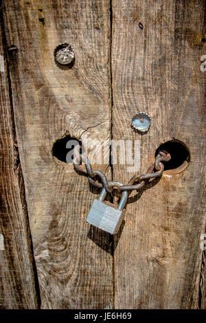 wooden door padlock security protection hacking_ - Stock Photo