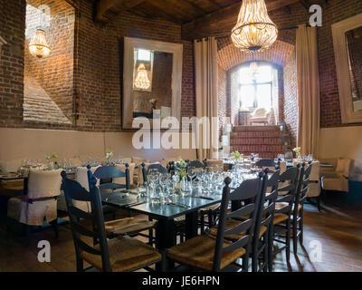 Laid dining tables in tower room of Burgundian tower of Duurstede castle in Wijk bij Duurstede in province Utrecht, - Stock Photo