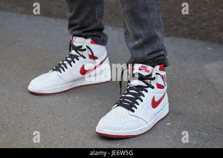 fcd74af54046 MILAN - JUNE 17  Man with white and red Nike air sneakers before Les Hommes