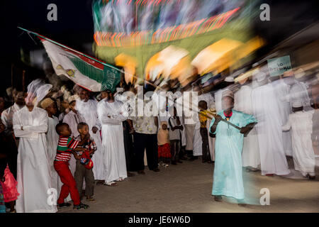 Muslims attend the Zefe procession during Maulidi festval, the birth of the prophet Mohammed, in front of Riada - Stock Photo