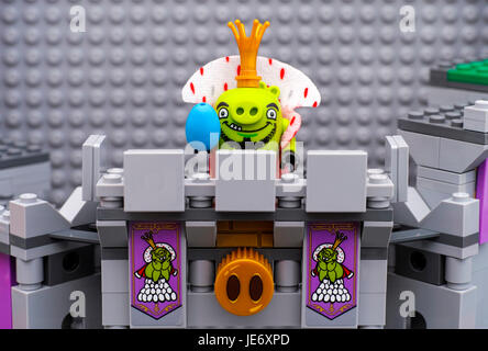 Tambov, Russian Federation - July 20, 2016 Lego Angry Birds. King Pig with blue egg standing on King Pig's Castle - Stock Photo