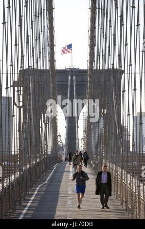 The USA, America, New York, Manhattan, jogger and pedestrian on Brooklyn Bridge, - Stock Photo