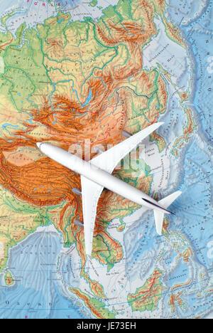 Airplane on a map of Asia, China, Japan, Korea, - Stock Photo
