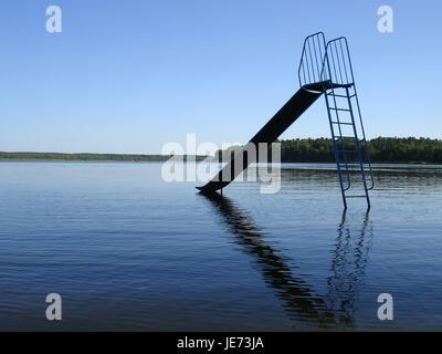Children's slide in the water, - Stock Photo