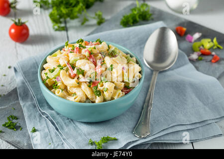 Yummy Homemade Macaroni Salad with Tomato Onion Celery and Parsley - Stock Photo
