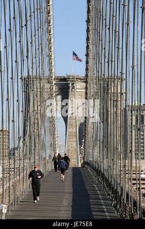 The USA, America, New York, Manhattan, jogger on Brooklyn Bridge, - Stock Photo