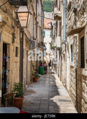 Narrow street in the Old City of Dubovnik on the Dalmatian Coast of Croatia - Stock Photo