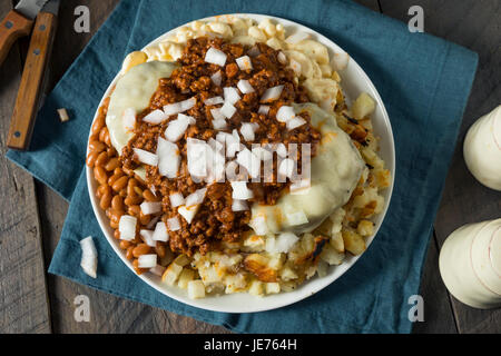 Unhealthy Homemade Beef Garbage Trash Plate with Potatoes Beans Macaroni Salad and Cheeseburgers - Stock Photo