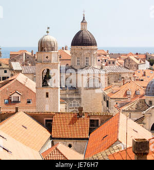 Bell tower and cathedral from the city walls of the medieval city of Dubrovnik on the Dalmation coast of Croatia - Stock Photo