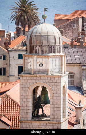 Bell tower sounding the hours over the medieval city of Dubrovnik on the Dalmation coast of Croatia - Stock Photo