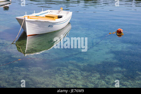Small boat in the shallow harbour of Pomena on the west coast of the island of Mljet in Croatia - Stock Photo