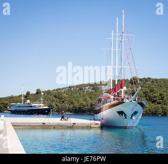 Boats in the small Adriatic port of Pomena on the island of Mlet Croatia - Stock Photo