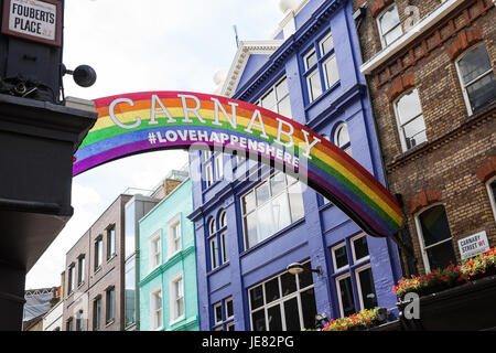 London, UK. 23rd June, 2017. Pride 2017 is launched with a 'Pride Arch' in Carnaby Street on the theme of Love Happens - Stock Photo