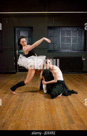 Two girl dancers practicing in the dance studio - Stock Photo