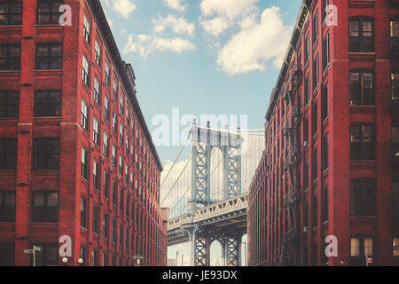 Color toned picture of Manhattan Bridge seen from Dumbo, New York City, USA. - Stock Photo