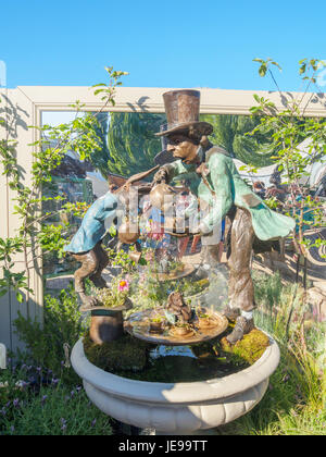 LONDON, UK - MAY 25, 2017: RHS Chelsea Flower Show 2017. Lewis Carroll's 'Alice in Wonderland' characters as sculptured - Stock Photo