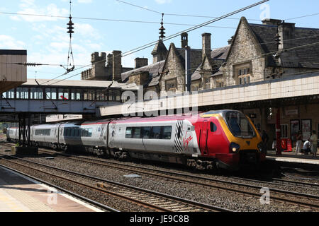 Virgin West Coast liveried super voyager class 221 diesel multiple unit train arriving at Lancaster railway station - Stock Photo