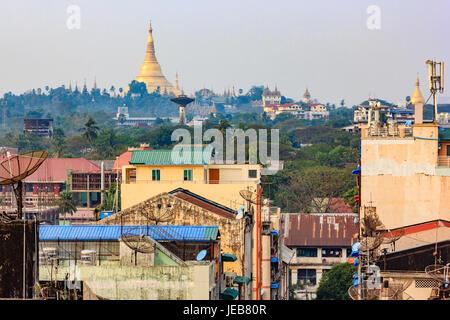 Yangon, Myanmar city skyline with Shwedagon Pagoda. - Stock Photo