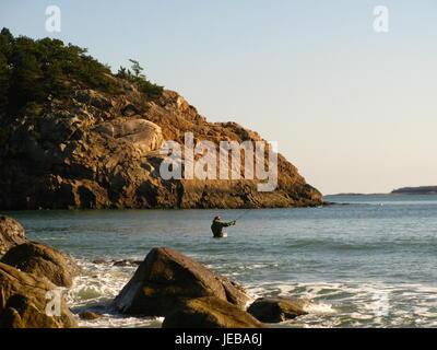 Fisherman in the sea - Stock Photo