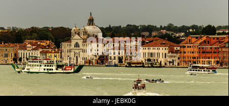 Traffic on the Grand Canal in Venice Italy, early morning. There are ferries, water taxis barges,police boats. All - Stock Photo