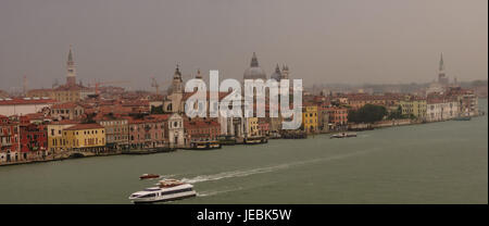 A view of the Grand Canal on a rainy foggy morning, already traffic is moving along the Grand Canal - Stock Photo