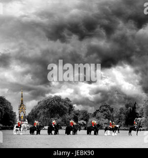 Soldiers on horse back with Albert Memorial in Background. London Hyde park - Stock Photo