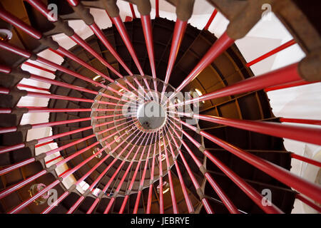 View up the steel double helix spiral staircase at the historic Ljubljana Castle tower on Castle Hill with red bar - Stock Photo