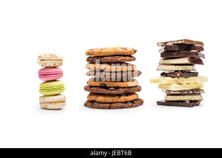 front view of macaroons, cookies and chocolate bars isolated on white - Stock Photo