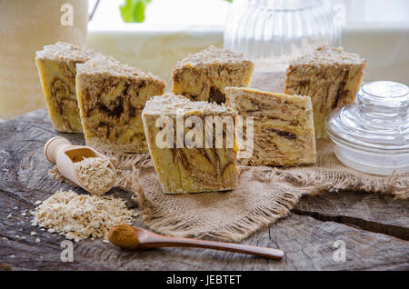 homemade oats and cinnamon soap using olive oil shea and cocoa butter - Stock Photo