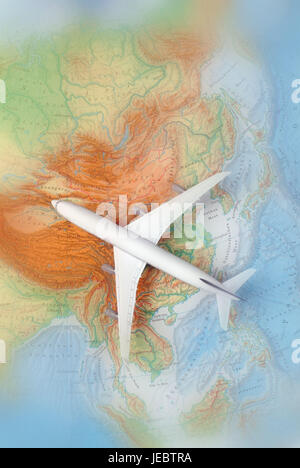 Airplane on a map of Asia, China, Japan, Korea, - Stock Photo
