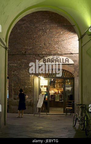 Italy, Tuscany, Lucca, input to a bar illuminateds at night, - Stock Photo