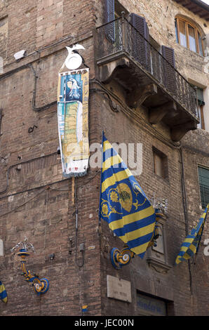 Italy, Tuscany, Siena, banner of silk in a house facade, - Stock Photo